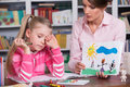 Child Psychologist Discusses Drawing A Little Girl Royalty Free Stock Photos - 35233128
