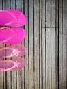 Brightly Colored Pink Flip-flops Of A Mother And Daughter On Woo Stock Photos - 35265553