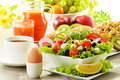 Breakfast With Coffee, Juice, Croissant, Salad, Muesli And Egg Stock Photos - 35266693