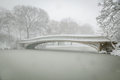Bow Bridge Covered In Snow, Central Park, NYC Royalty Free Stock Photography - 35270617