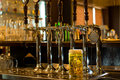 Tankard Of Beer With Beer Taps In A Pub Royalty Free Stock Photography - 35280487
