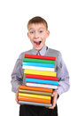 Boy Holding Pile Of The Books Royalty Free Stock Photography - 35291457