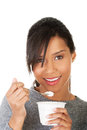 Young Woman Eating Yogurt As Healthy Breakfast Or Snack. Stock Photography - 35292732