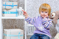 Cute Little Boy Pointing At Gift Boxes Stock Photo - 35310630
