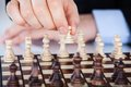 Mature Businessman Playing Chess Royalty Free Stock Photos - 35315268