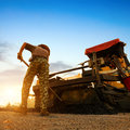 Dusk, Road Workers Are Working. Royalty Free Stock Photo - 35324455