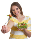 Woman With Long Brown Hair Eating Salad Stock Images - 35335504