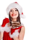 Christmas Girl In Red Santa Hat Eating Cake On Plate. Royalty Free Stock Image - 35353406
