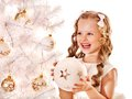 Child Decorate White Christmas Tree. Stock Photography - 35353622