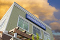Immediate Care Sign On Hospital Building With Clouds Royalty Free Stock Photography - 35361327