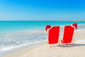Santa Hat On Chaise Longues At White Sand Beach Against The Sea Stock Images - 35363444