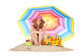 Sunbathing At The Beach With Colorful Parasol Royalty Free Stock Image - 35364156