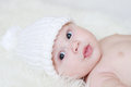 Lovely Baby In White Knitted Hat Stock Images - 35377864