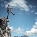 Stepping Off A Cliff Ledge Royalty Free Stock Photography - 35389617
