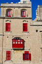 Red Balconies And Red Windows Stock Images - 35392964