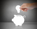 Male Hand Putting Light Bulb Into A Piggy Bank Stock Images - 35401734