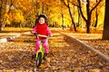 Girl Riding Bicycle On Autumn Rode Stock Image - 35428551