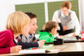 Education - Pupils And Teacher Learning At School Royalty Free Stock Images - 35450819