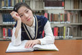 Student With Open Textbook Deep In Thought Stock Photos - 35495223