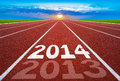 New Year 2014 On Running Track Concept With Sun & Blue Sky. Stock Photography - 35505402