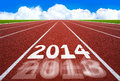 New Year 2014 On Running Track Concept With Blue Sky. Royalty Free Stock Photos - 35506878