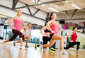 Group Of Smiling People Exercising In The Gym Stock Image - 35508061