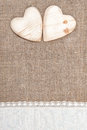 Burlap Background With Lacy Cloth And Wooden Hearts Royalty Free Stock Photo - 35514525