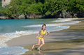 Happy Girl Plays In Sea On Tropical Beach Royalty Free Stock Photos - 35515838