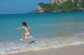 Happy Girl Plays In Sea On Tropical Beach Royalty Free Stock Images - 35516049
