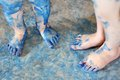 Children S Blue Painted Feet Royalty Free Stock Photo - 35544845