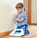 Girl  Playing With  Iron Royalty Free Stock Images - 35560759