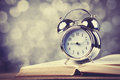 Alarm Clock And Book Stock Images - 35576564