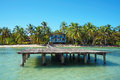 Dock With Beach House And Coconut Trees Stock Images - 35577954