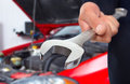 Hand With Wrench. Auto Mechanic. Royalty Free Stock Photography - 35580247