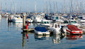 Motor Boats In A Marina With Masts And Calm Blue Sea Royalty Free Stock Photo - 35580325