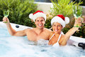 Happy Christmas Santa Couple In Jacuzzi. Stock Images - 35580514