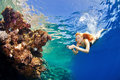 Girl And Corals In The Sea Royalty Free Stock Photography - 35602947