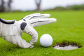 Close-up Of A Man S Hand Putting Golf Ball In Hole Stock Photography - 35608682