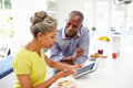 Mature African American Couple Using Digital Tablet At Home Stock Photos - 35612713