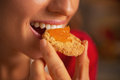 Young Woman Eating Cookie With Orange Jam Stock Image - 35620421