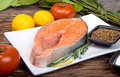 Fresh Raw Salmon Red Fish Steak With Herbs And Vegetables Stock Images - 35648844