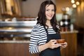 Beautiful Waitress Holding Coffee Cup In Cafeteria Stock Photo - 35649560