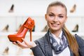 Woman Keeping Orange Leather Shoe Royalty Free Stock Photos - 35655168
