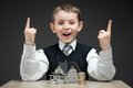 Little Boy With House Model And Pile Of Coins Royalty Free Stock Image - 35656186