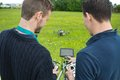 Engineers Operating UAV Helicopter Stock Photo - 35688980