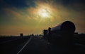 Gasoline Tanker Rides The Highway In The Evening Sun Rays Royalty Free Stock Images - 35689939