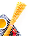 Uncooked Spaghetti With Tomatoes And Olive Oil Royalty Free Stock Image - 35698076