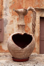 Old Greek Vase With A Heart-shaped Whole Stock Photography - 35705012