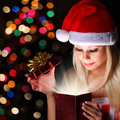 Christmas Miracle. Happy Blonde Girl With Santa Hat Opening Gift Royalty Free Stock Photo - 35712925