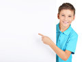 Portrait Of  Cheerful Boy Pointing On White Banner Royalty Free Stock Images - 35728639